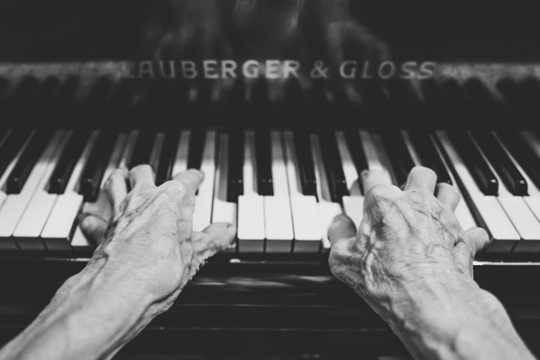 elderly piano player